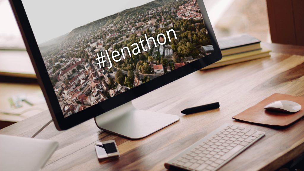 Ein Computerbildschirm zeigt ein Bild von Jena mit dem Schriftzug Jenathon.